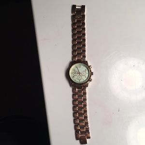 Loosely fitting gold and teal boyfriend watch